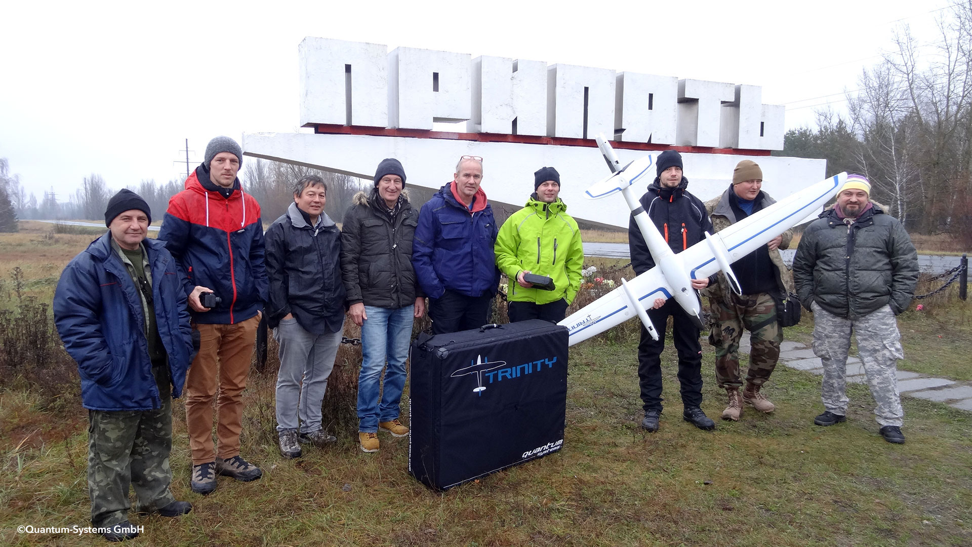 Figure 5: Research team of the University of Applied Sciences Munich, Dr. Norbert Molitor (third from left) and coworker of the NPP Chernobyl with the deployed drone of Quantum Systems (Photo: Karl Siebold)
